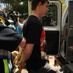 Colorado University Senior's Gabriel Kuettel is patted down for transportation after being arrested for trespassing on the Norlin Quad that is closed to crackdown on pro-marijuana protesters on 4-20-12 at the school in Boulder, Colo., Friday, April 20, 2012. A block-long line of protesters marched onto the University of Colorado, testing the school's determination to push the annual April 20 marijuana celebration off campus.