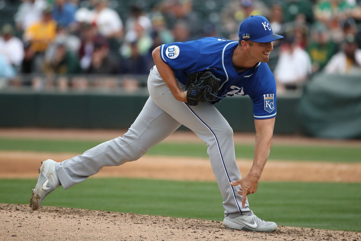 Relief pitcher Foster Griffin #60 of the Kansas City Royals pitches against the Oakland Athletics during the MLB spring training game at HoHoKam Stadium on March 10, 2020 in Mesa, Arizona.