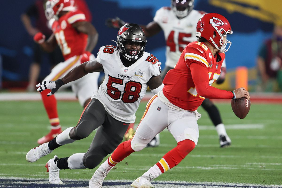 Kansas City Chiefs quarterback Patrick Mahomes (15) is chased by Tampa Bay Buccaneers outside linebacker Shaquil Barrett (58) in the second half during Super Bowl LV at Raymond James Stadium.