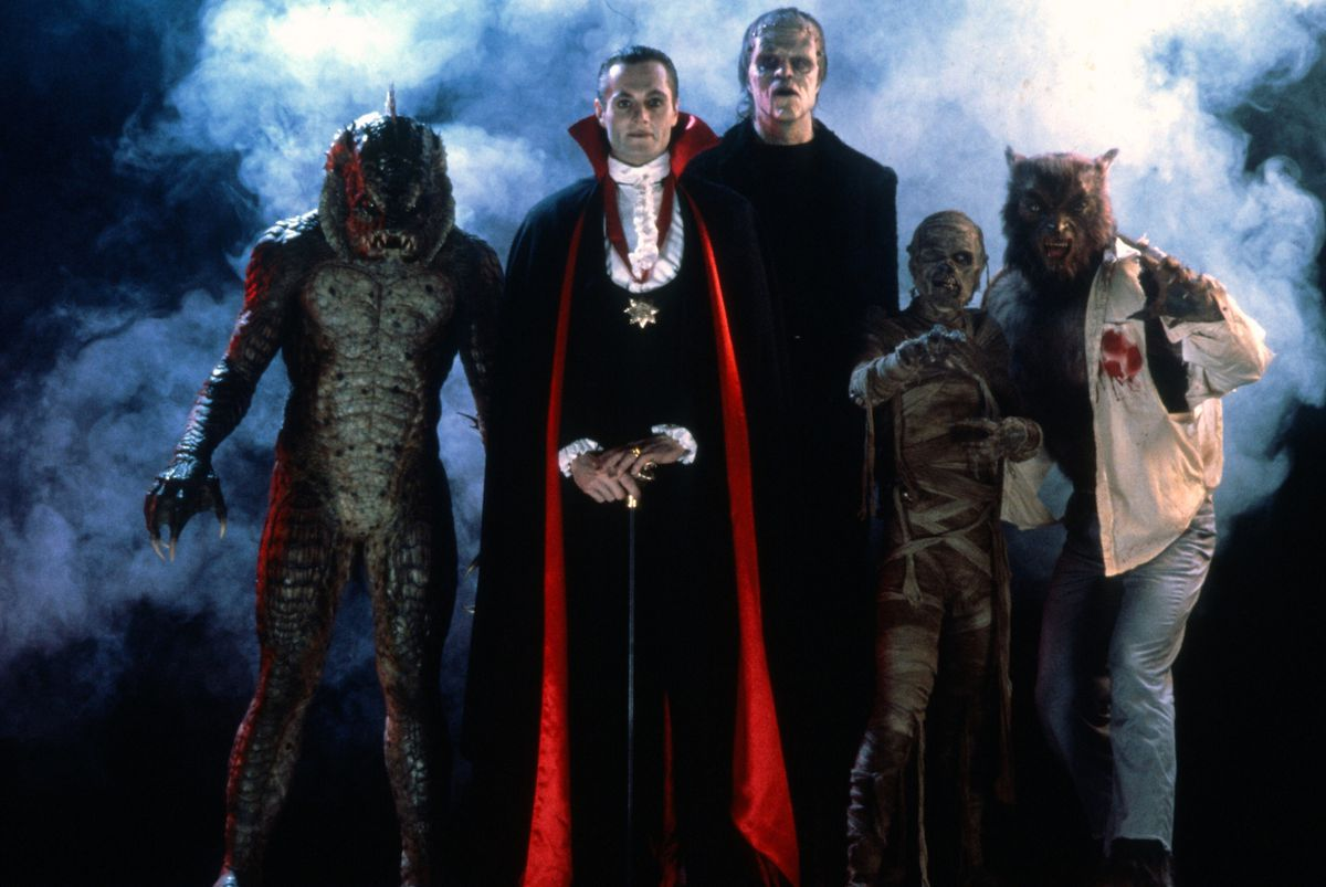A group of classic monsters standing in the fog.