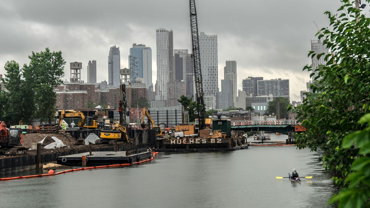 A kayaker paddles toward construction on the Gowanus Canal, July 10, 2020.