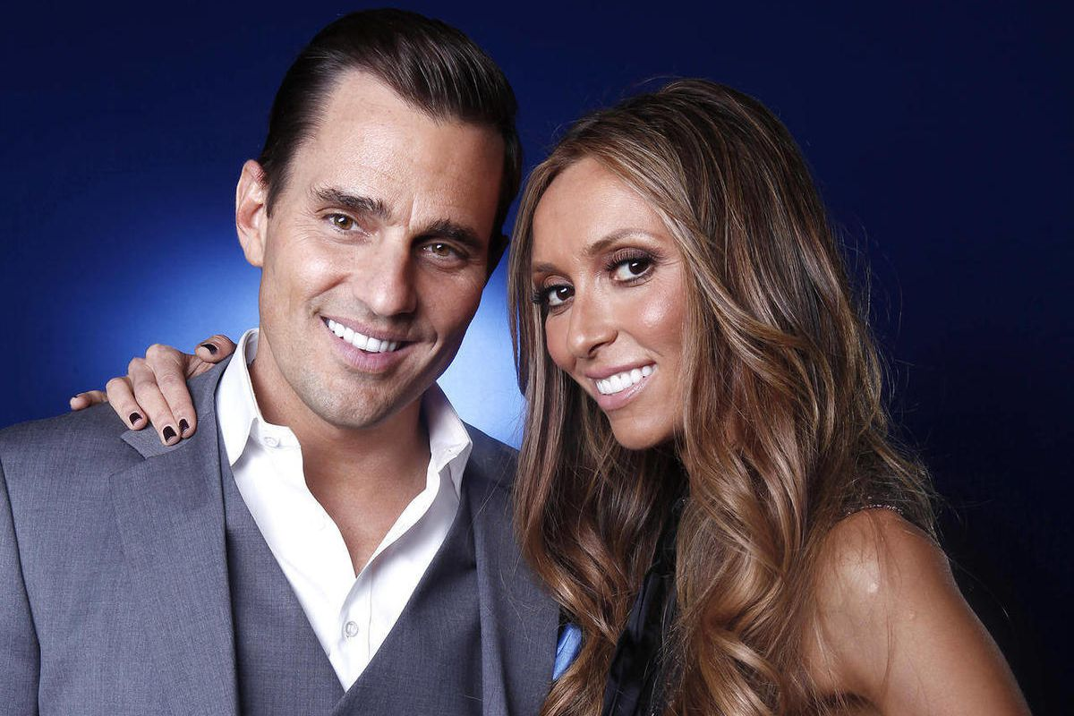 FILE - In this April 2, 2012 file photo, Bill and Giuliana Rancic pose for a portrait in New York. The Rancics are expecting their first child via a gestational surrogate.