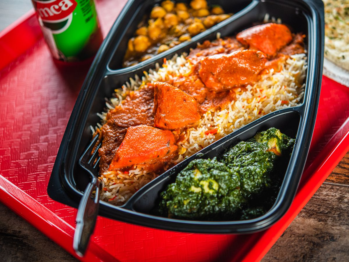 A tray off butter chicken with saag paneer and chana masala at Butter Chicken Company