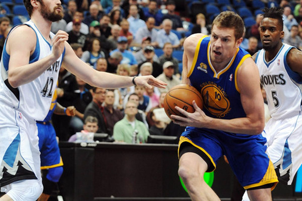 APR 4, 2012; Minneapolis, MN, USA;   Golden State Warriors forward David Lee (10) drives to the basket past Minnesota Timberwolves forward Kevin Love (42) in the first quarter at Target Center.     Mandatory Credit: Marilyn Indahl-US PRESSWIRE