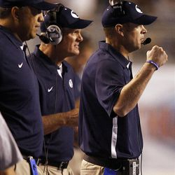 Head coach Bronco Mendenhall of the Brigham Young Cougars gestures to his defense during NCAA football in Boise, Thursday, Sept. 20, 2012.