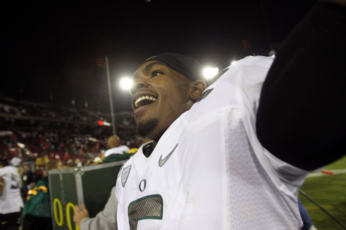 STANFORD, CA - NOVEMBER 12:  Darron Thomas #5 of the Oregon Ducks celebrates after they beat the Stanford Cardinal at Stanford Stadium on November 12, 2011 in Stanford, California.  (Photo by Ezra Shaw/Getty Images)