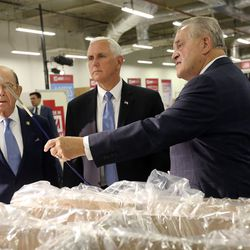 Secretary of Commerce Wilbur Ross, left, and Vice President Mike Pence, center, tour a clean room with Fred Lampropoulos, founder, chairman and CEO of Merit Medical, in the Rex and Anita Bean Building at the Merit Medical headquarters in South Jordan on Thursday, Aug. 22, 2019.