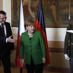 Czech Republic's Prime Minister Petr Necas, left, welcomes German Chancellor Angela Merkel, right, at the government's headquarters in Prague, Czech Republic, Tuesday, April 3, 2012. Merkel is in Czech Republic on a one-day official visit.