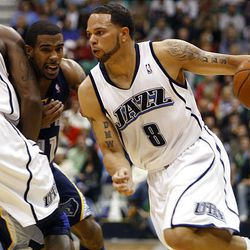 Utah Jazz guard Deron Williams (8) escapes past Memphis Grizzlies guard Mike Conley (11) as Utah Jazz forward Paul Millsap (24) sets a pick at the Energy Solutions Arena in Salt Lake City on  Tuesday, Feb. 17, 2009.
