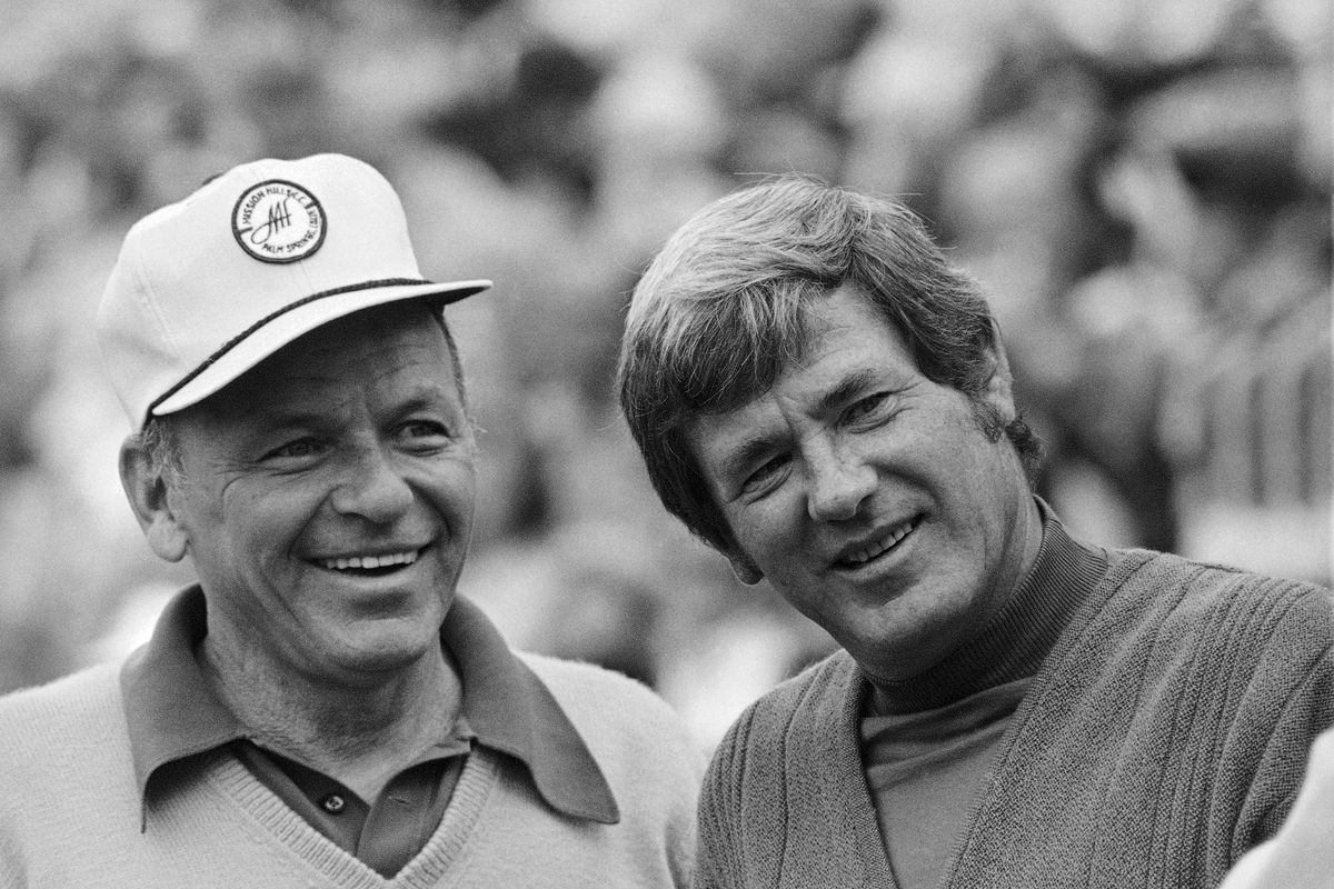 Doug Sanders, right, stands with Frank Sinatra  at the Bermuda Dunes Country Club in Bermuda Dunes, Calif., in 1973. Sanders died Sunday in Houston at age 86.