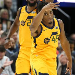 Utah Jazz forward Royce O'Neale (23) and guard Donovan Mitchell (45) celebrate after Mitchell scored three against the Denver Nuggets at Vivint Smart Home Arena in Salt Lake City on Tuesday, Nov. 28, 2017.