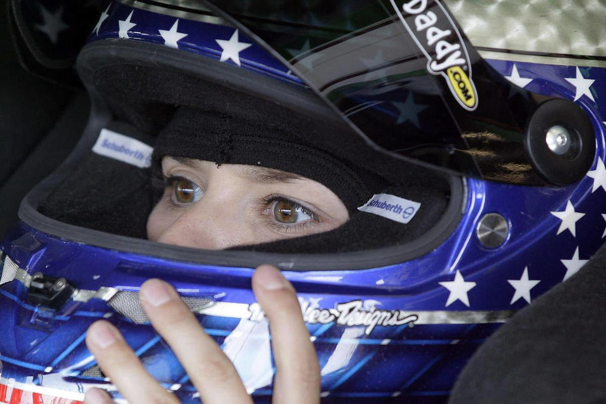 Danica Patrick checks her helmet in her car during practice for the NASCAR Sprint Cup Series auto race at Chicagoland Speedway in Joliet, Ill., Friday, Sept. 14, 2012.