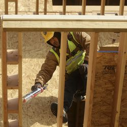 Pedro Carranza, Morin Construction foreman, works at the construction site of Capitol Homes Apartments, a mixed-income, mixed-use development at 1749 S. State in Salt Lake City on Wednesday, Dec. 9, 2020.