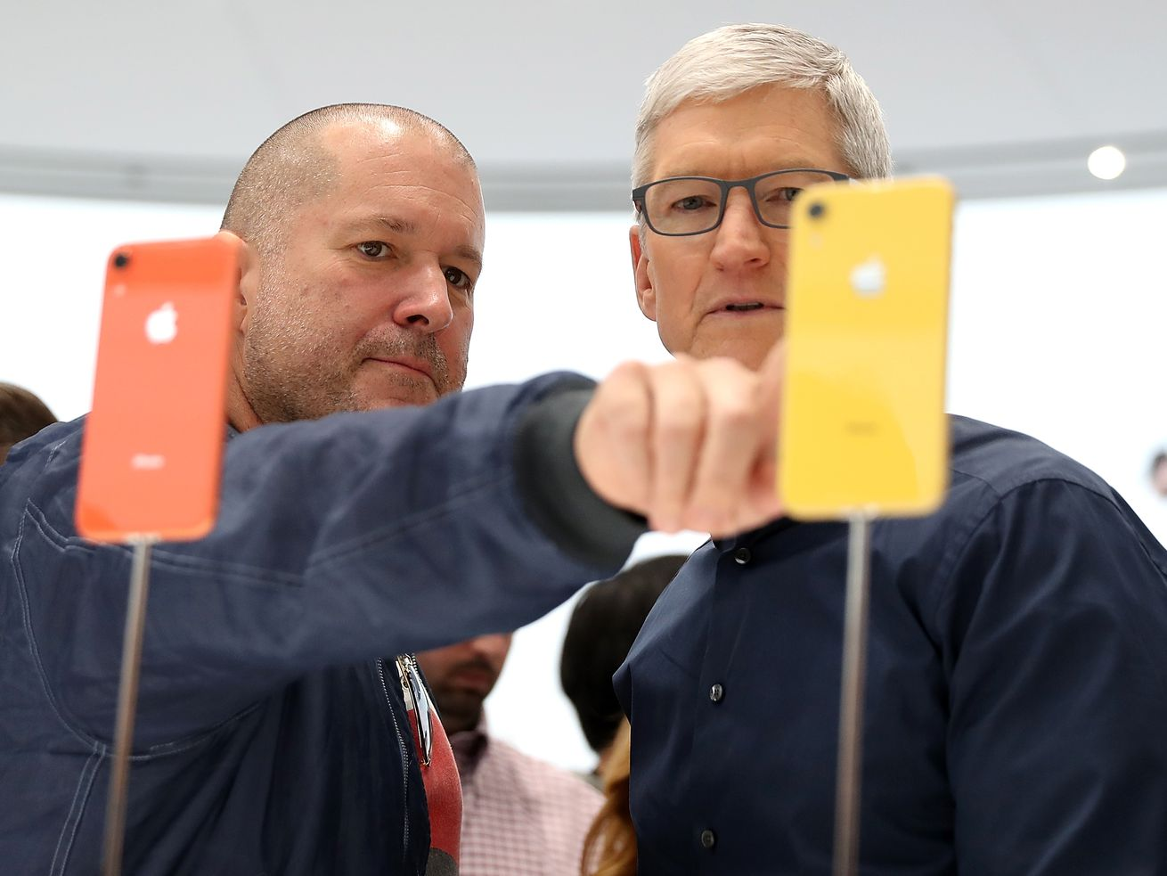 Apple Chief Design Officer Jony Ive and CEO Tim Cook inspect the new iPhone XR during an Apple special event at the Steve Jobs Theatre on September 12, 2018, in Cupertino, Calif.