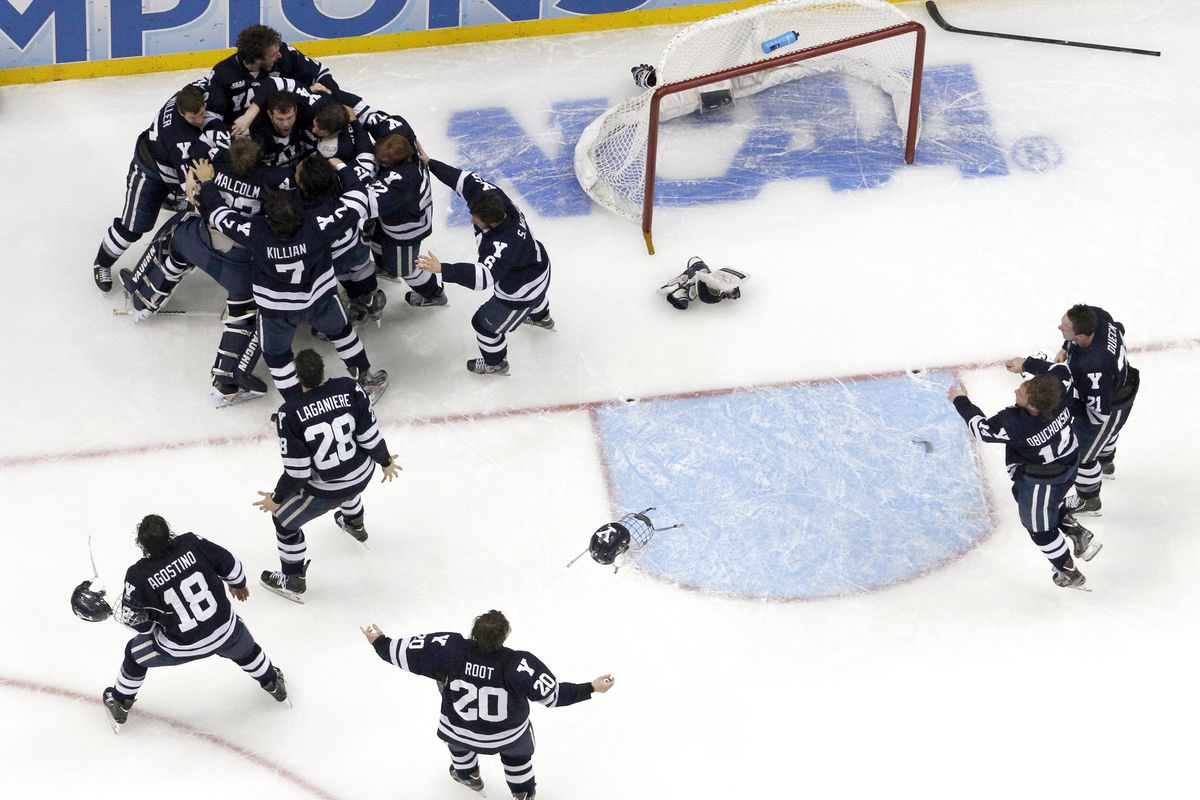 Yale players celebrate the national championship at the Frozen Four.