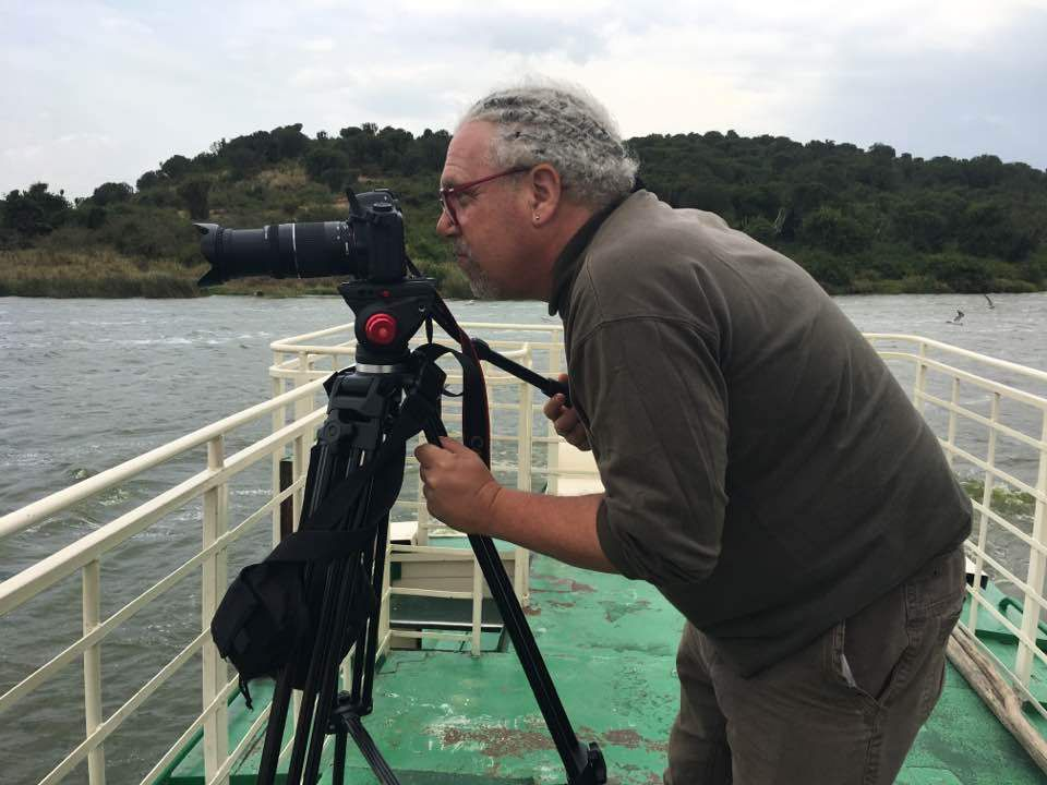 David J. Steiner frames a shot while filming a documentary about Sudanese refugees in Uganda. | Provided photo