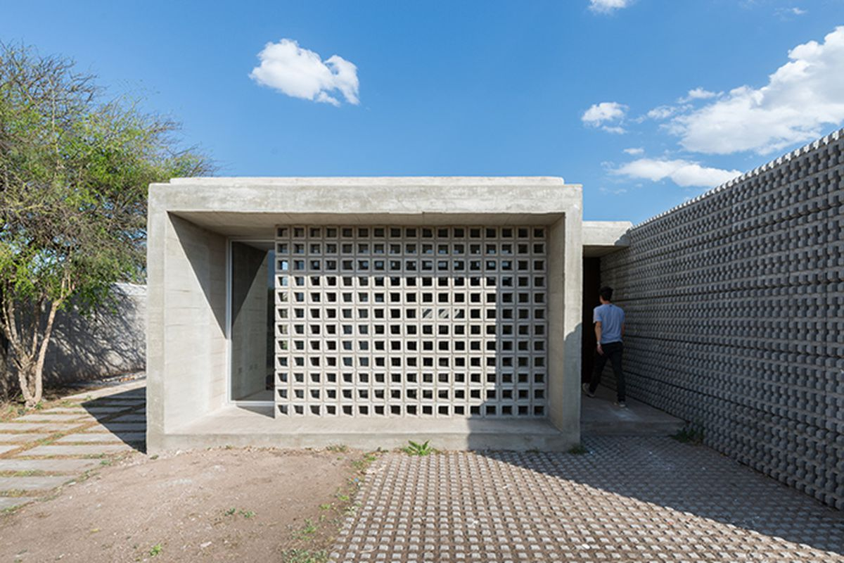 Concrete homes offer modern design on a budget in for Concrete block house