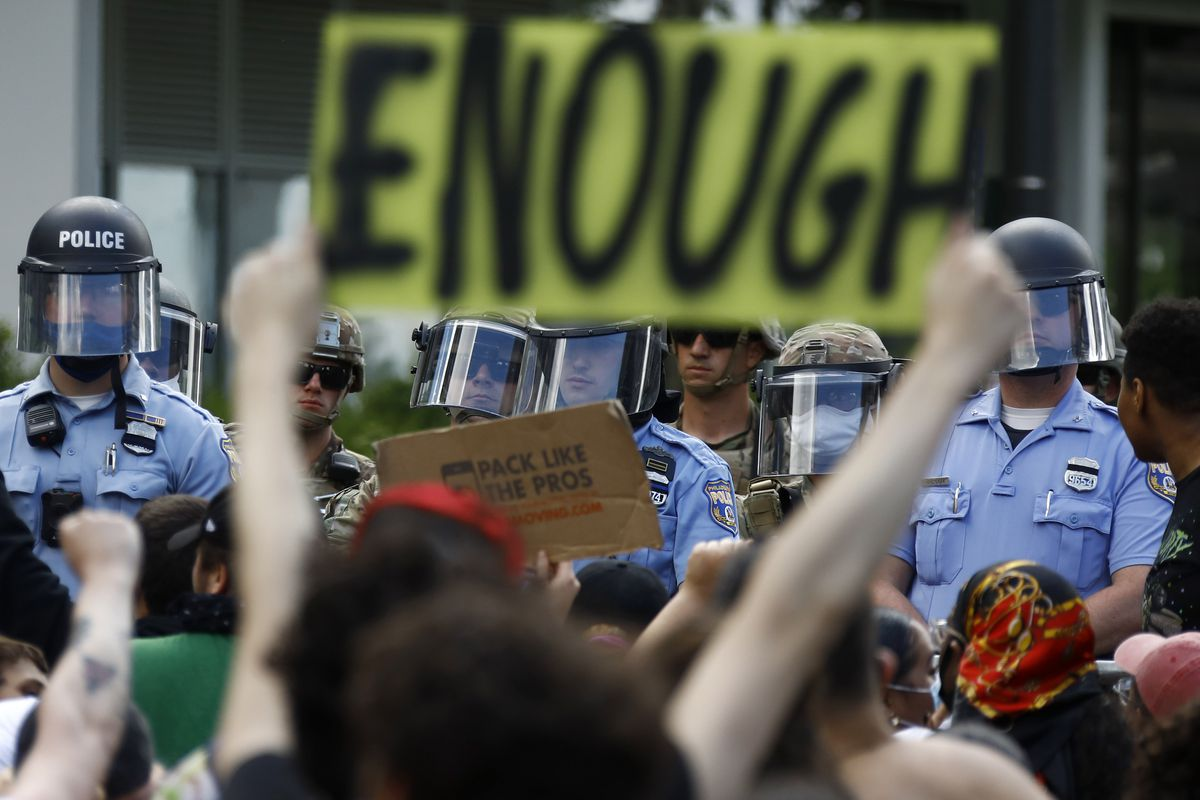 Protesters rally as Philadelphia Police officers and Pennsylvania National Guard soldiers look on, Monday, June 1, 2020, in Philadelphia, over the death of George Floyd, a black man who was in police custody in Minneapolis. Floyd died after being restrained by Minneapolis police officers on May 25.