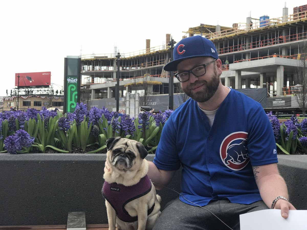 Wrigleyville resident Matt McHale, 34, attends the recently opened park beside Wrigley Field and brings along his pug, Daisy.   Andrea Salcedo/For the Sun-Times