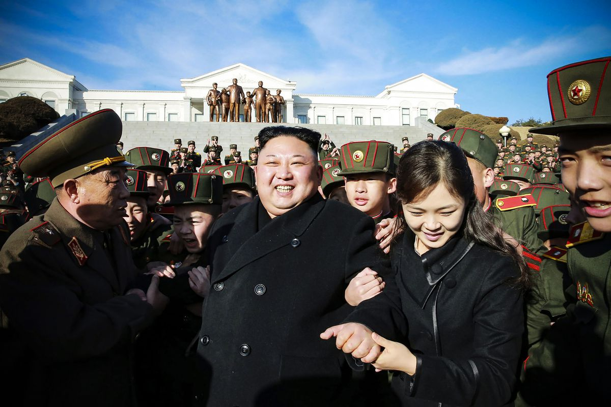 Kim Jong Un and his wife, Ri Sol Ju, visiting the Mangyongdae Revolutionary School in Pyongyang to plant trees with its students in March 2017.