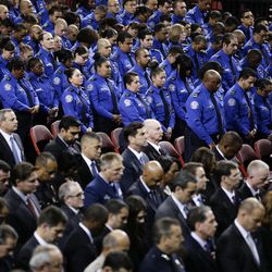 Transportation Security Administration officers attend the public memorial service for TSA officer Gerardo Hernandez, who was killed by a rampaging gunman at the Los Angeles International Airport, on Tuesday, Nov. 12, 2013, in Los Angeles. Hundreds of colleagues of Hernandez celebrated his life Tuesday at an emotional service that included prayers, song and memories of a cheerful man who colleagues said cherished his family.
