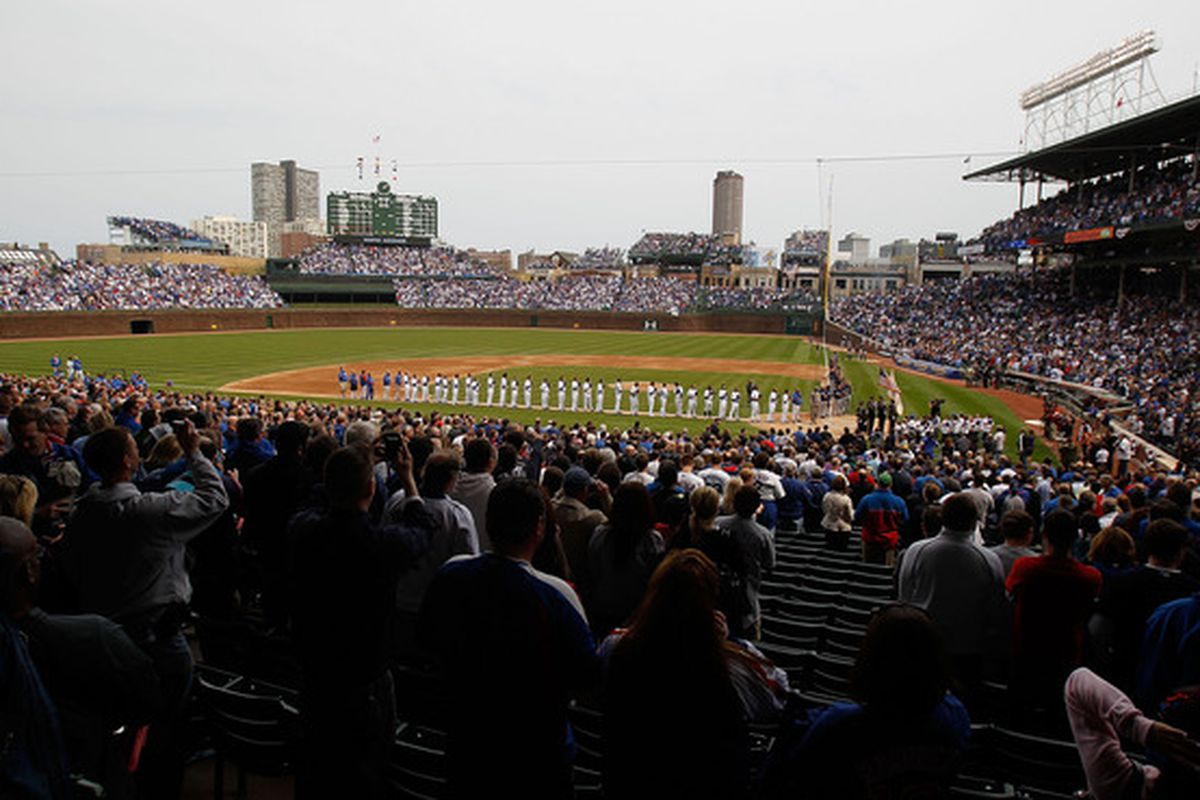 Members of the Chicago Cubs and the Milwaukee Brewers stand for the National Anthem on Opening Day last year at Wrigley Field in Chicago, Illinois. (Photo by Jonathan Daniel/Getty Images)