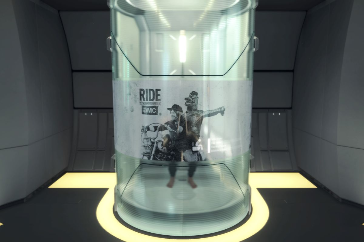 Norman Reedus is obscured as he poops in his private room in Death Stranding. There's an advertisement for his TV show Ride on the glass the hides the act.