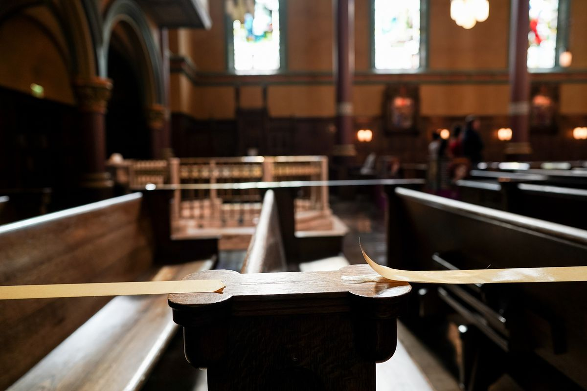 Some pews are taped off to preserve social distancing during Mass at the Cathedral of the Madeleine on Tuesday, May 12, 2020.