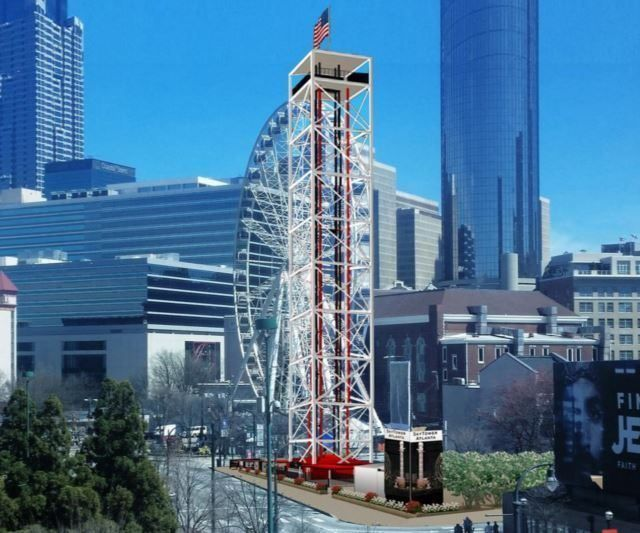 A rendering of SkyTower Thrill Park in Atlanta. There is a ferris wheel. The park is surrounded by city buildings.