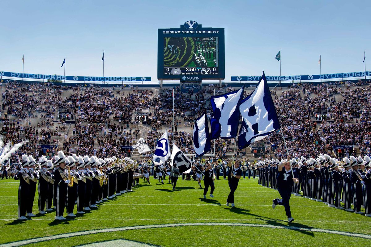 BYU Flags lead the Cougars on the field