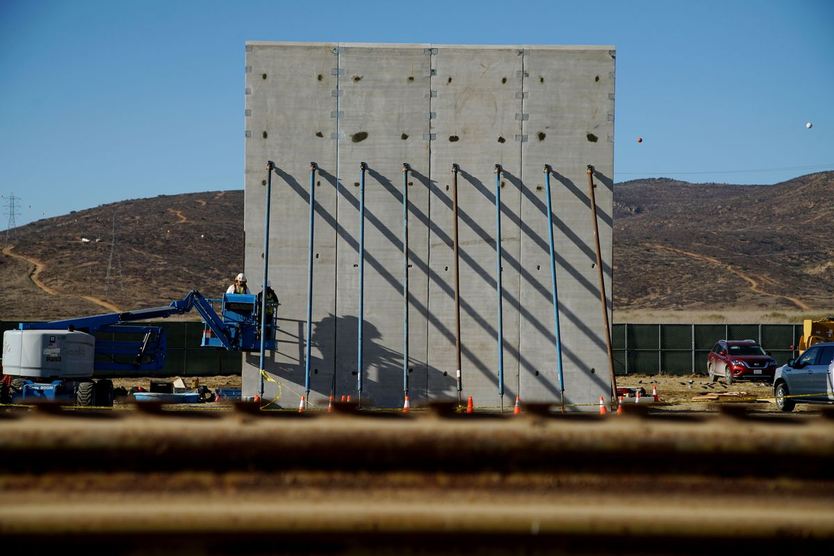 Prototype sections of a border wall between Mexico and the United States under construction in Tijuana Mexico