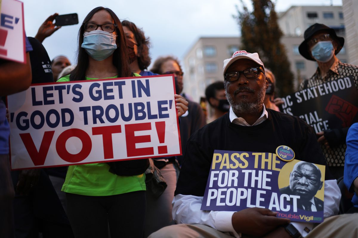 """Voting rights activists take part in a """"Good Trouble Candlelight Vigil for Democracy"""" at Black Lives Matter Plaza July 17, 2021 in Washington, DC."""