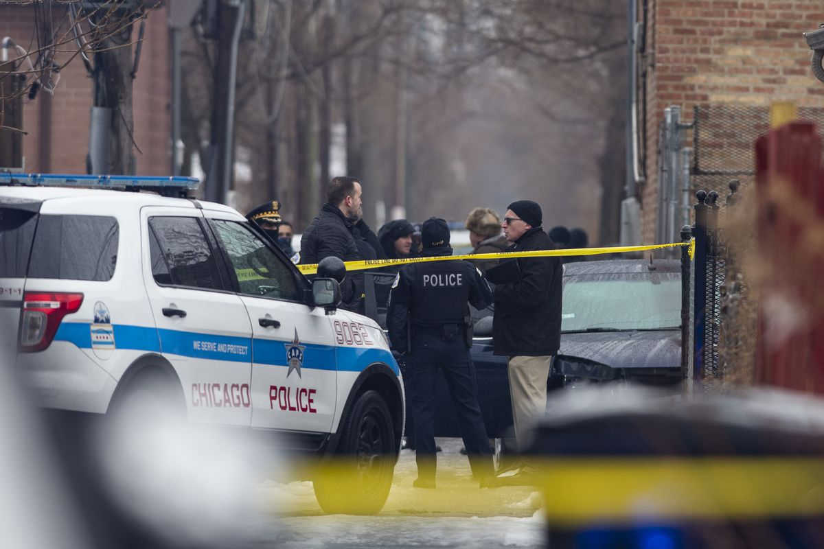 Chicago police investigate the scene of a officer involved shooting in an alleyway near the 1300 block of South Kedvale Ave. in the Lawndale neighborhood, Friday, Jan. 1, 2020.