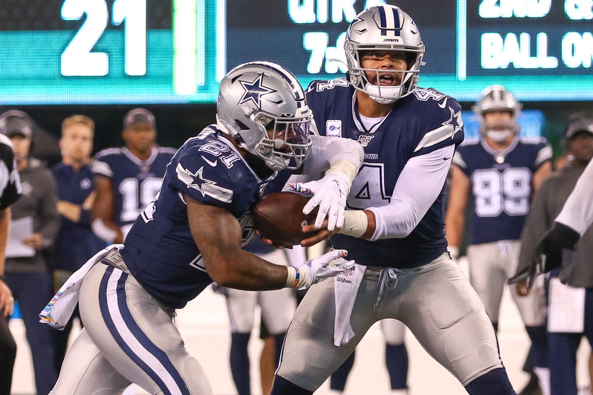 Dallas Cowboys Quarterback Dak Prescott hands the ball off to Running Back Ezekiel Elliott during the fourth quarter of the National Football League game between the Cowboys and the New York Jets on October 13, 2019 in East Rutherford, NJ.