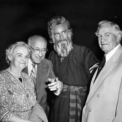 """LDS Church President David O. McKay and his wife, Emma Ray Riggs McKay, with famed movie director Cecil B. DeMille, left center, on the set of """"The Ten Commandments"""" with movie star Charlton Heston, who played Moses, center right, in 1955."""
