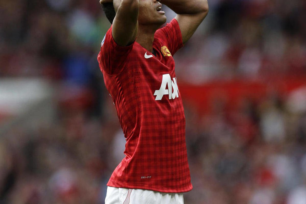 Manchester United's Nani reacts after a missed opportunity during his team's English Premier League soccer match against Wigan Athletic at Old Trafford Stadium, Manchester, England, Saturday, Sept. 15, 2012.