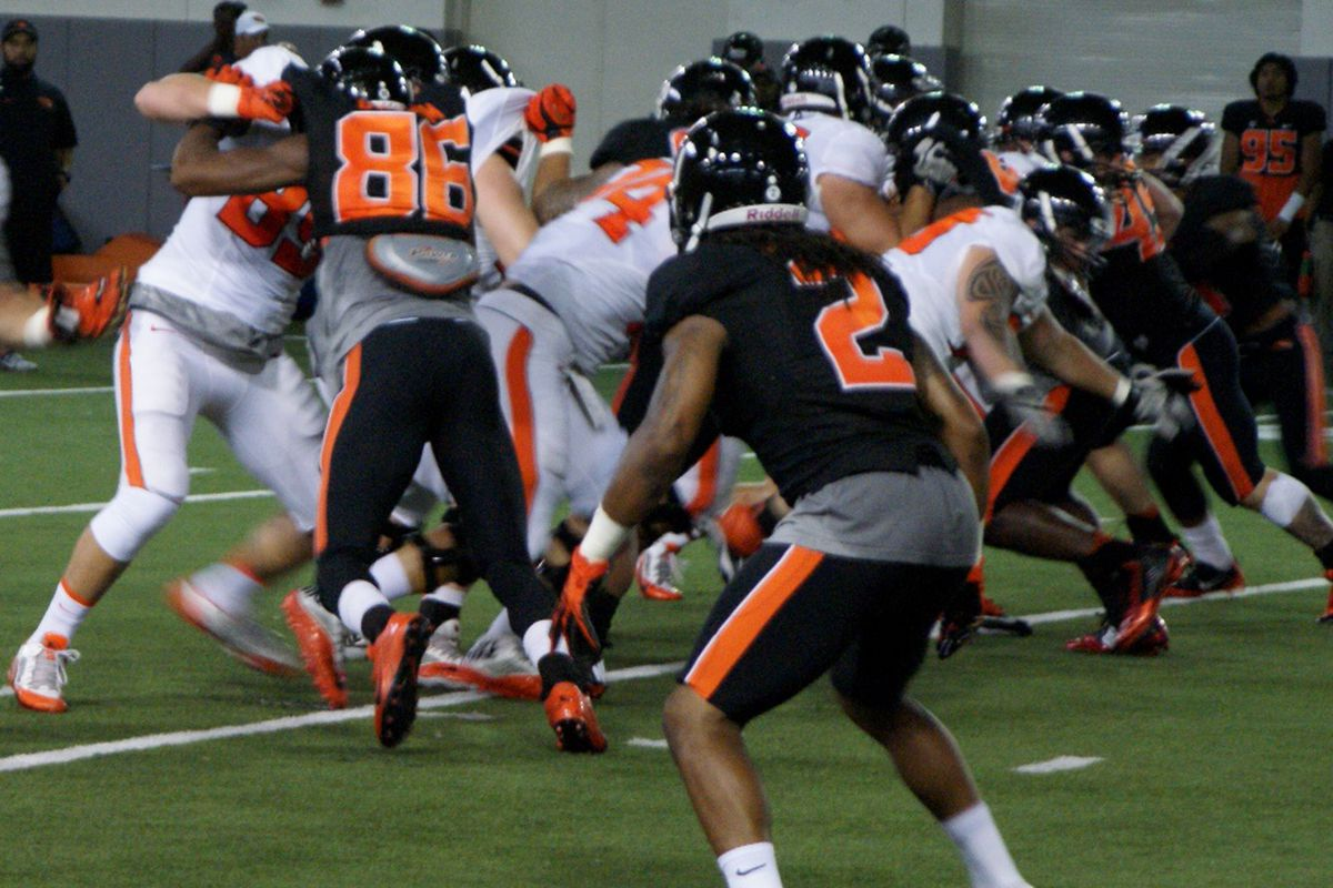 Practice for Oregon St. moved inside when thunderstorms moved through Corvallis today, but the defense continued to bottle up the offense despite the change of scenery.