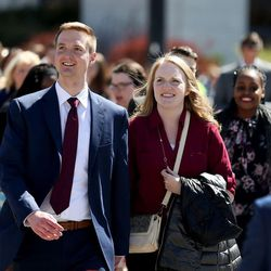 People walk to the 187th Annual General Conference of The Church of Jesus Christ of Latter-day Saints in Salt Lake City on Saturday, April 1, 2017.