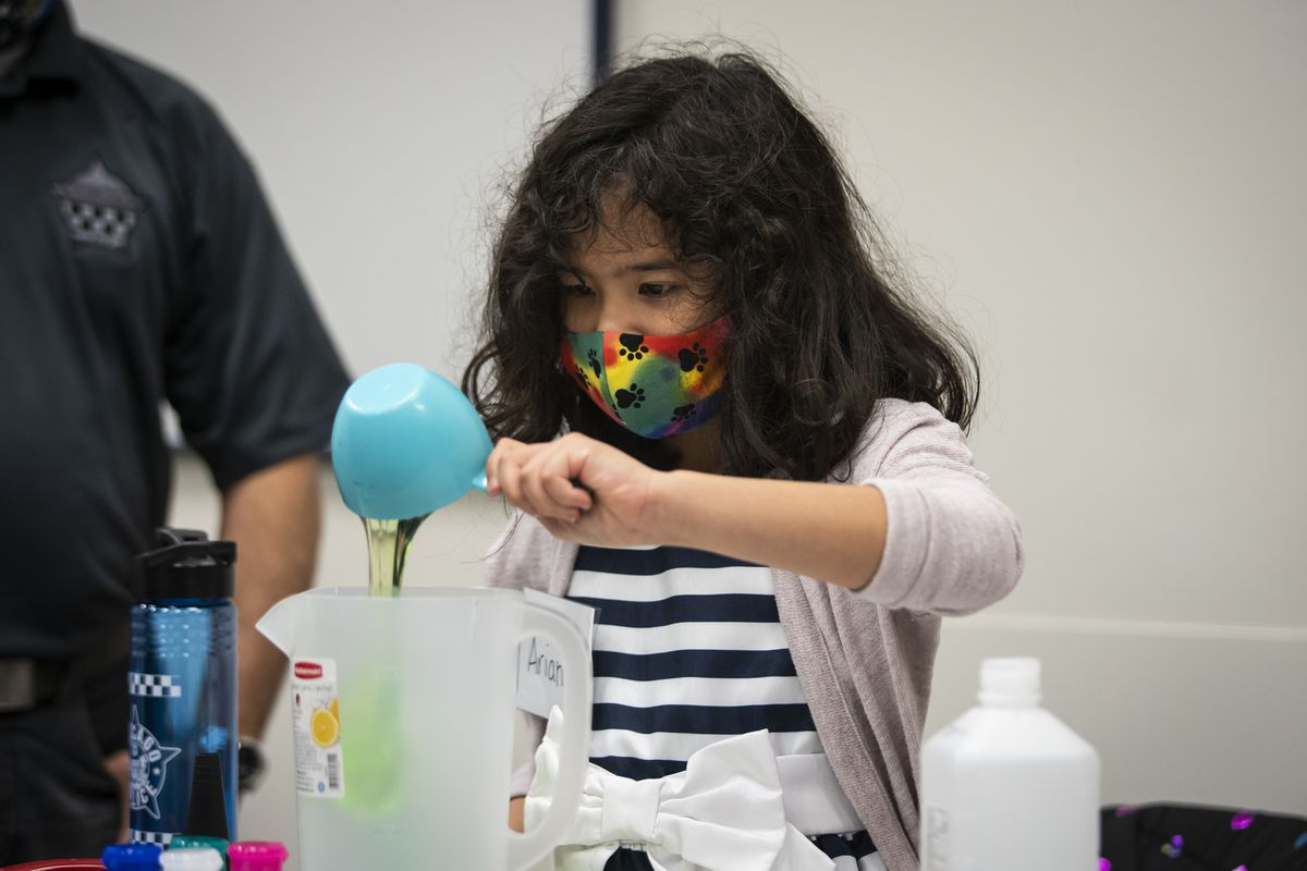 Arianna Stagen, 7, of Humboldt Park, demonstrates with her sisters how they made a batch of homemade hand sanitizer to donate to the Chicago Police Department during a press conference with Supt. David Brown at CPD headquarters, Wednesday afternoon, April 29, 2020.