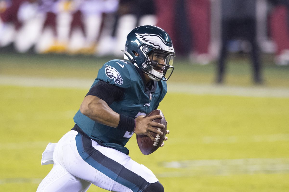 Jalen Hurts #2 of the Philadelphia Eagles runs with the ball against the Washington Football Team at Lincoln Financial Field on January 3, 2021 in Philadelphia, Pennsylvania.