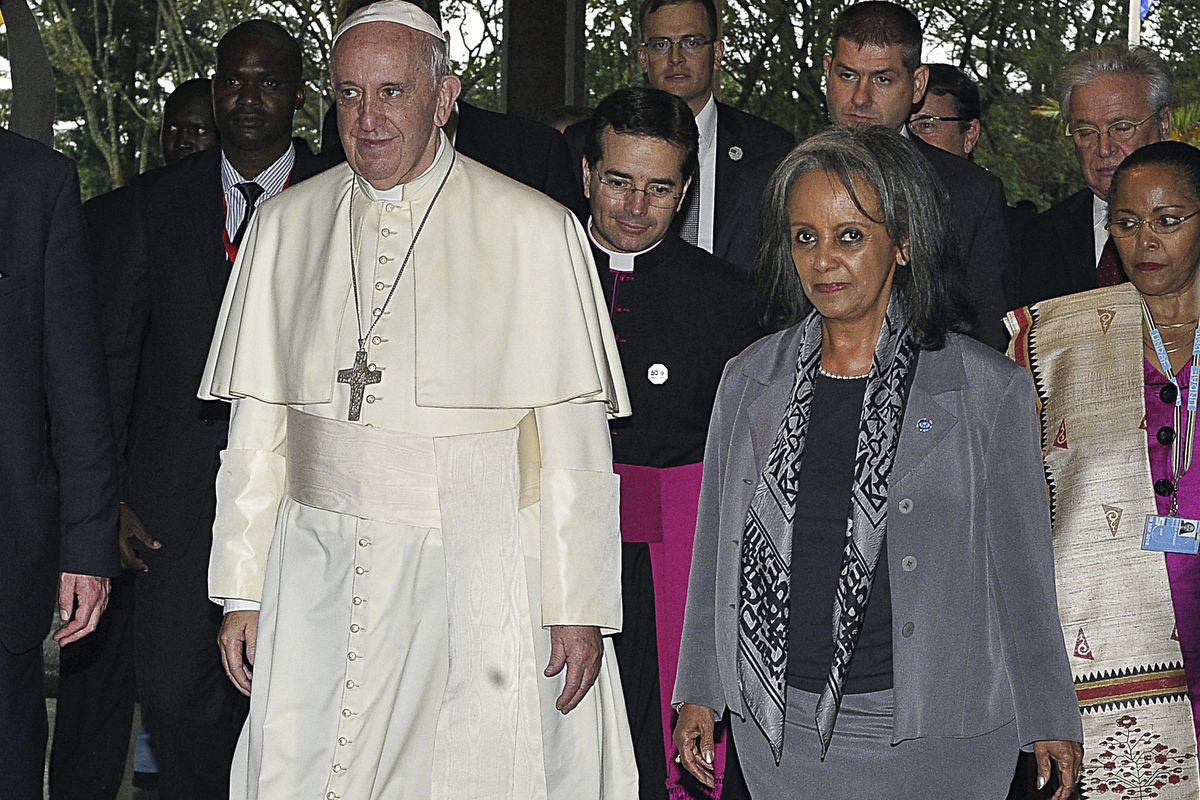 FILE - In this Thursday, Nov. 26, 2015 file photo, Pope Francis walks next to then Director-General of the United Nations Office at Nairobi (UNON) Sahle-Work Zewde, right, upon his arrival there in Nairobi, Kenya. Ethiopian lawmakers unanimously elected t
