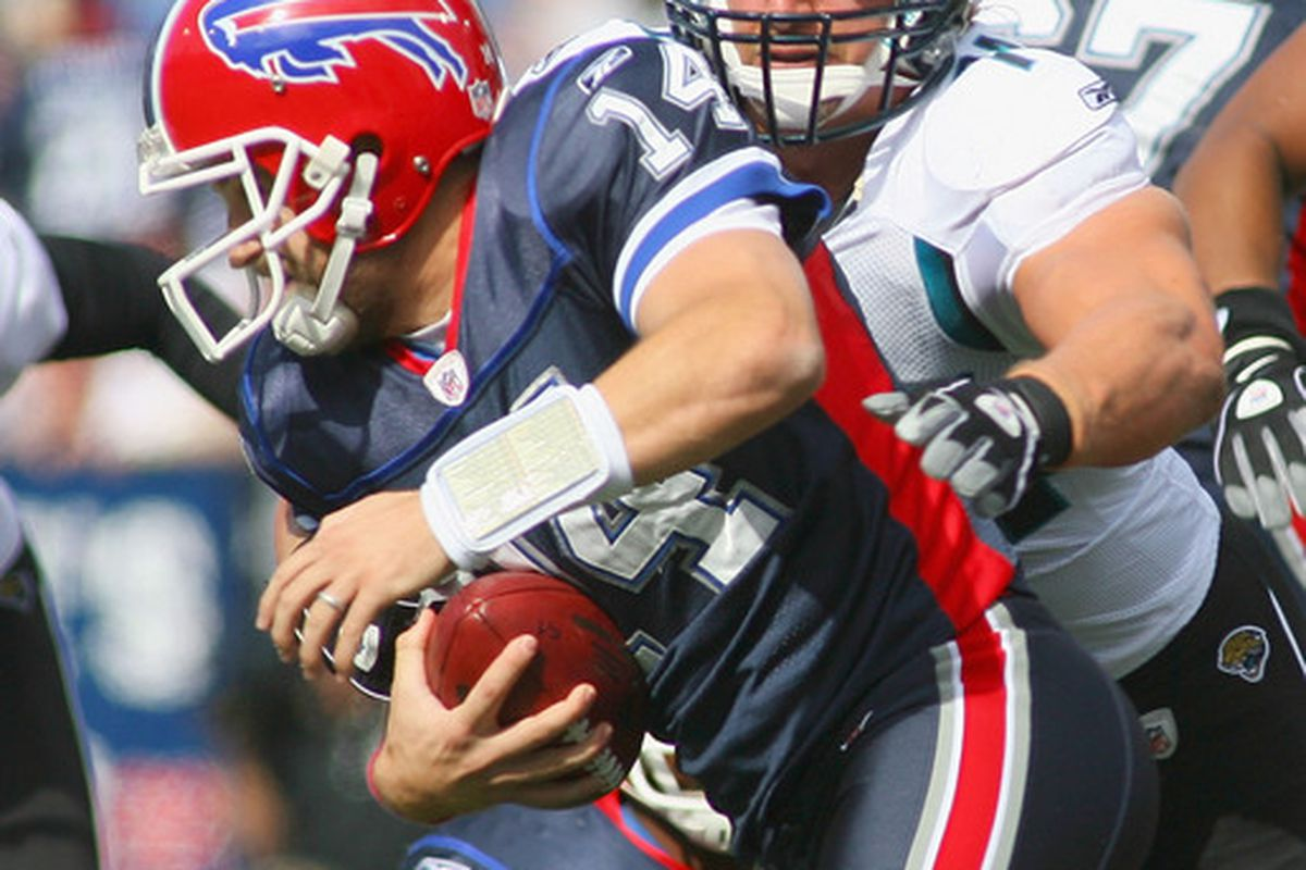 ORCHARD PARK, NY - OCTOBER 10: Ryan Fitzpatrick #14 of the Buffalo Bills is sacked by Aaron Kampman  #74 of the Jacksonville Jaguars at Ralph Wilson Stadium on October 10, 2010 in Orchard Park, New York.  (Photo by Rick Stewart/Getty Images)