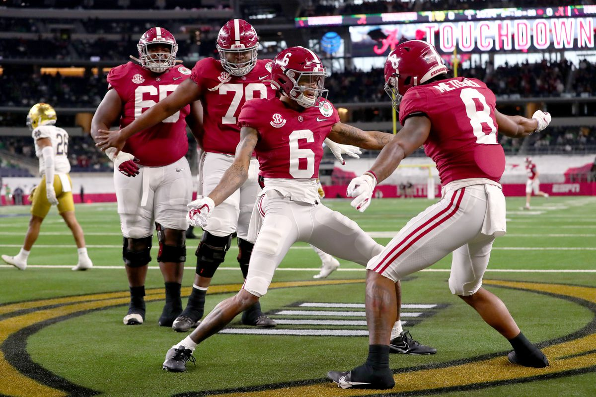 Wide receiver DeVonta Smith of the Alabama Crimson Tide celebrates his touchdown with teammate wide receiver John Metchie III in the first quarter of the 2021 College Football Playoff Semifinal Game at the Rose Bowl Game presented by Capital One against Notre Dame Fighting Irish at AT&T Stadium on January 01, 2021 in Arlington, Texas.