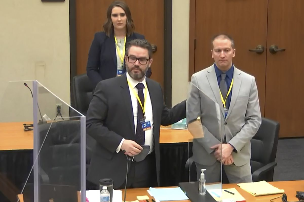 In this screen grab from video, defense attorney Eric Nelson, left, defendant and former Minneapolis police officer Derek Chauvin, right, and Nelson's assistant Amy Voss, back, introduce themselves to jurors as Hennepin County Judge PeterCahill presides over jury selection in the trial of Chauvin.