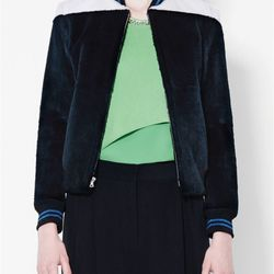 """Fur bomber jacket with contrast color yolk, $600 (via <a href=""""http://www.lyst.com/clothing/31-phillip-lim-fur-bomber-jacket-with-contrast-color-yoke-midnight/""""> Lyst </a>)"""