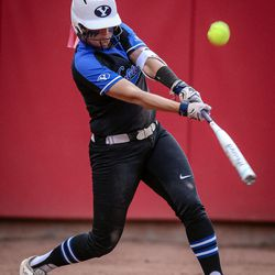 BYU infielder Briielle Breland (12) hits a pop up as the University of Utah hosts Brigham Young University at Duke Stadium in Salt Lake City on Wednesday, April 18, 2018.