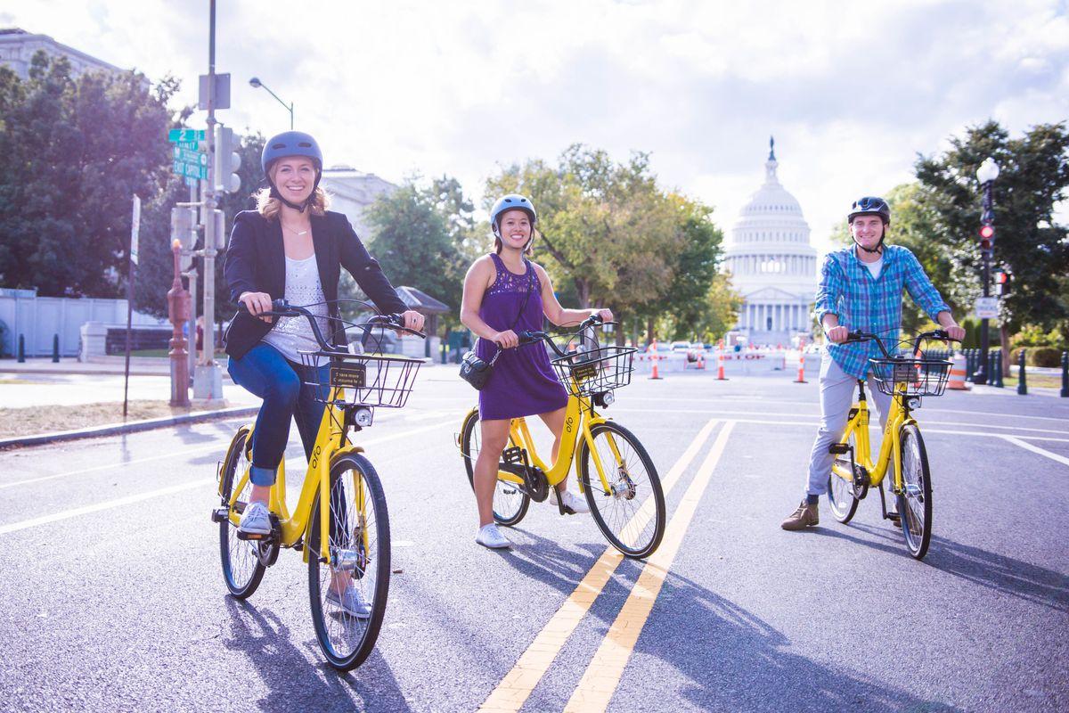 People ride bright yellow Ofo bikes in Washington D.C.