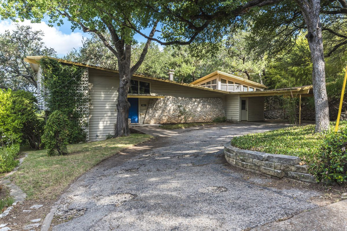 Midcentury house with angled roof, curved front driveway