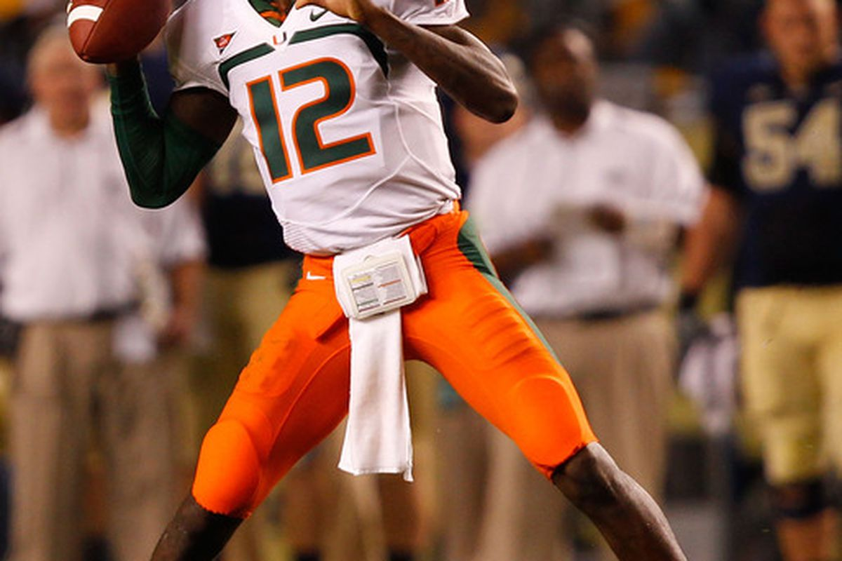 PITTSBURGH - SEPTEMBER 23:  Jacory Harris #12 of the Miami Hurricanes drops back to pass against the Pittsburgh Panthers on September 23 2010 at Heinz Field in Pittsburgh Pennsylvania.  (Photo by Jared Wickerham/Getty Images)