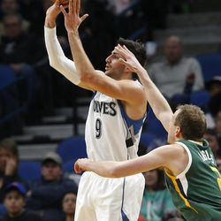 Minnesota Timberwolves' Ricky Rubio, left, of Spain, shoots as Utah Jazz's Joe Ingles, of Australia, defends during the first quarter of an NBA basketball game Saturday, Jan. 7, 2017, in Minneapolis.